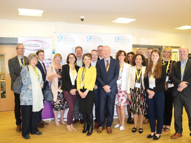 Staff of City of Bristol College stand with participants of a 'Future of the Skills System' roundtable