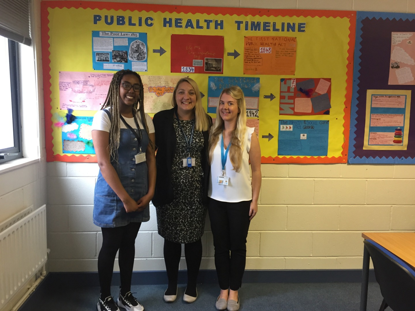 City of Bristol College student, Nneka Hitchcock, studying BTEC Health & Social Care and Rachel Bailey, BTEC Childcare Tutor, stand for a photo with Rachel Bailey, teacher at City of Bristol College