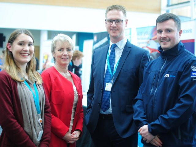 MP Karin Smyth, Lee Probert, Principal and Chief Executive for City of Bristol College, and two students stand in-front of a jobs fair displays