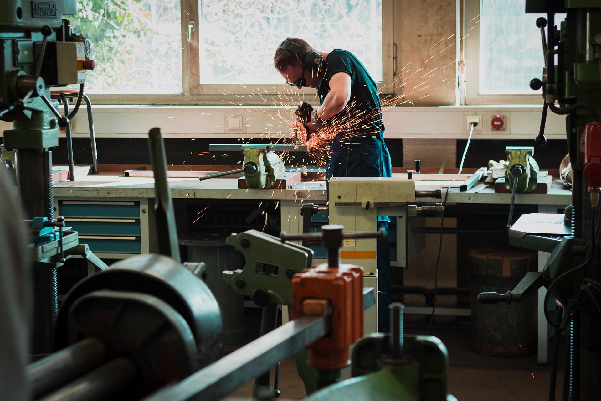 Angle grinder being used in workshop