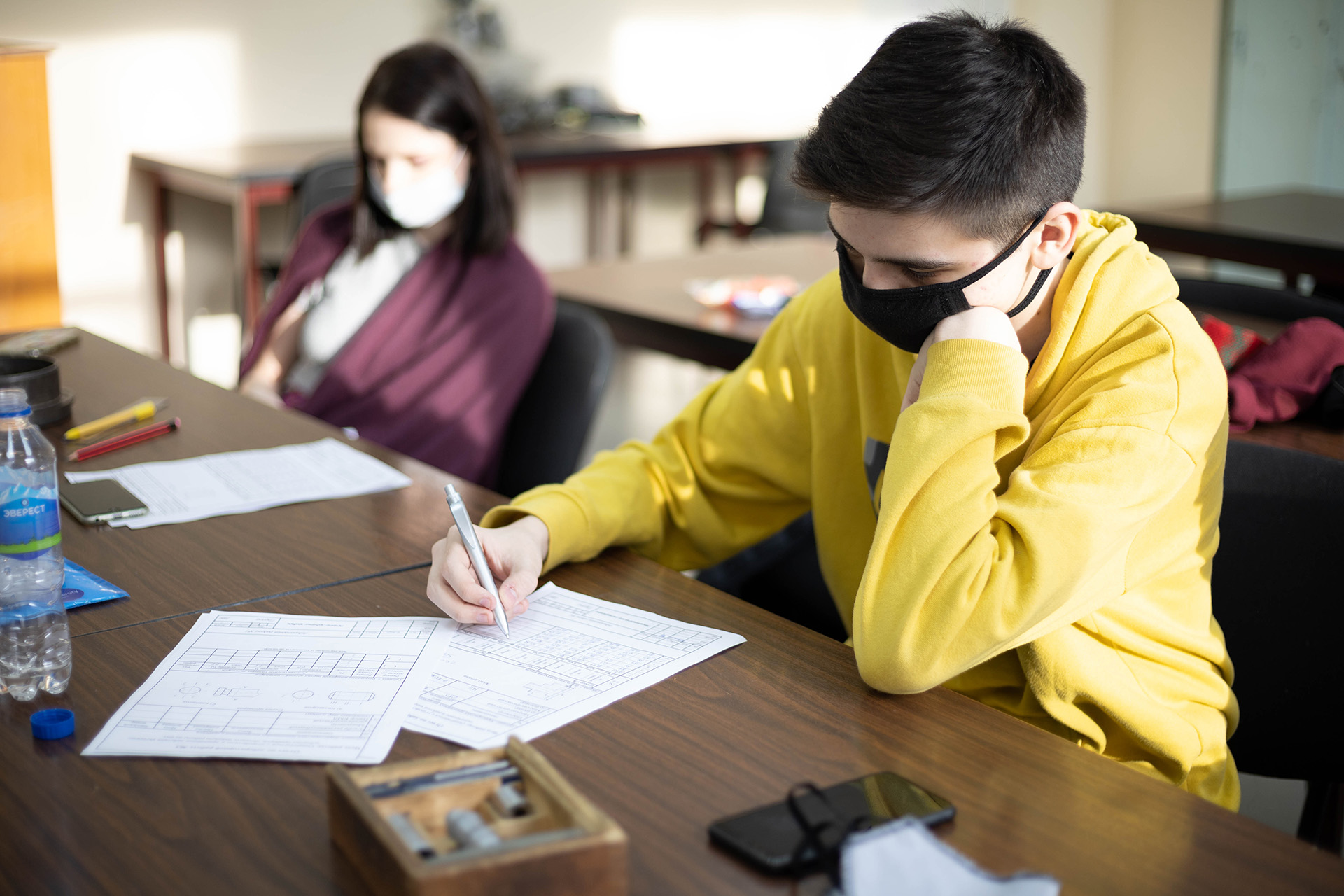 Students working wearing masks
