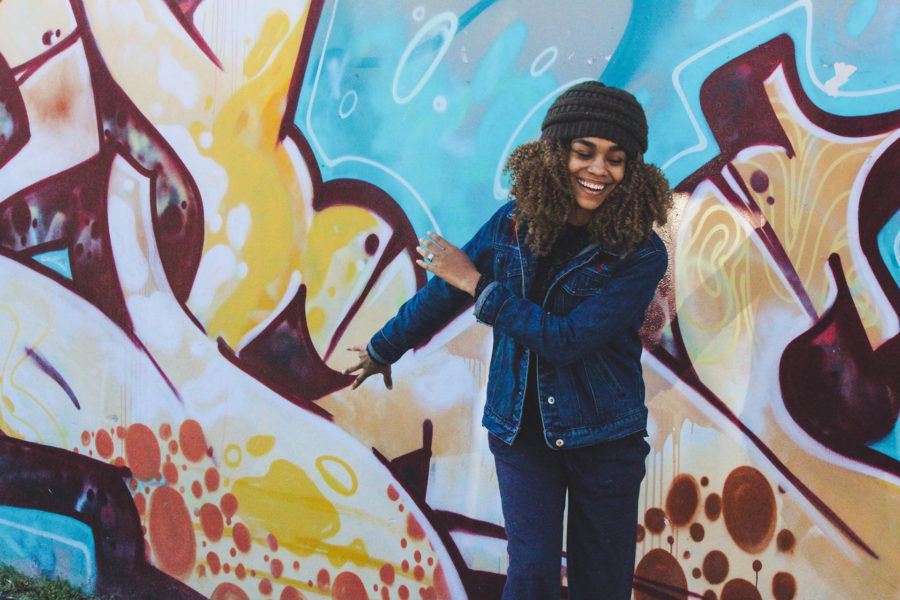 Student in front of graffiti