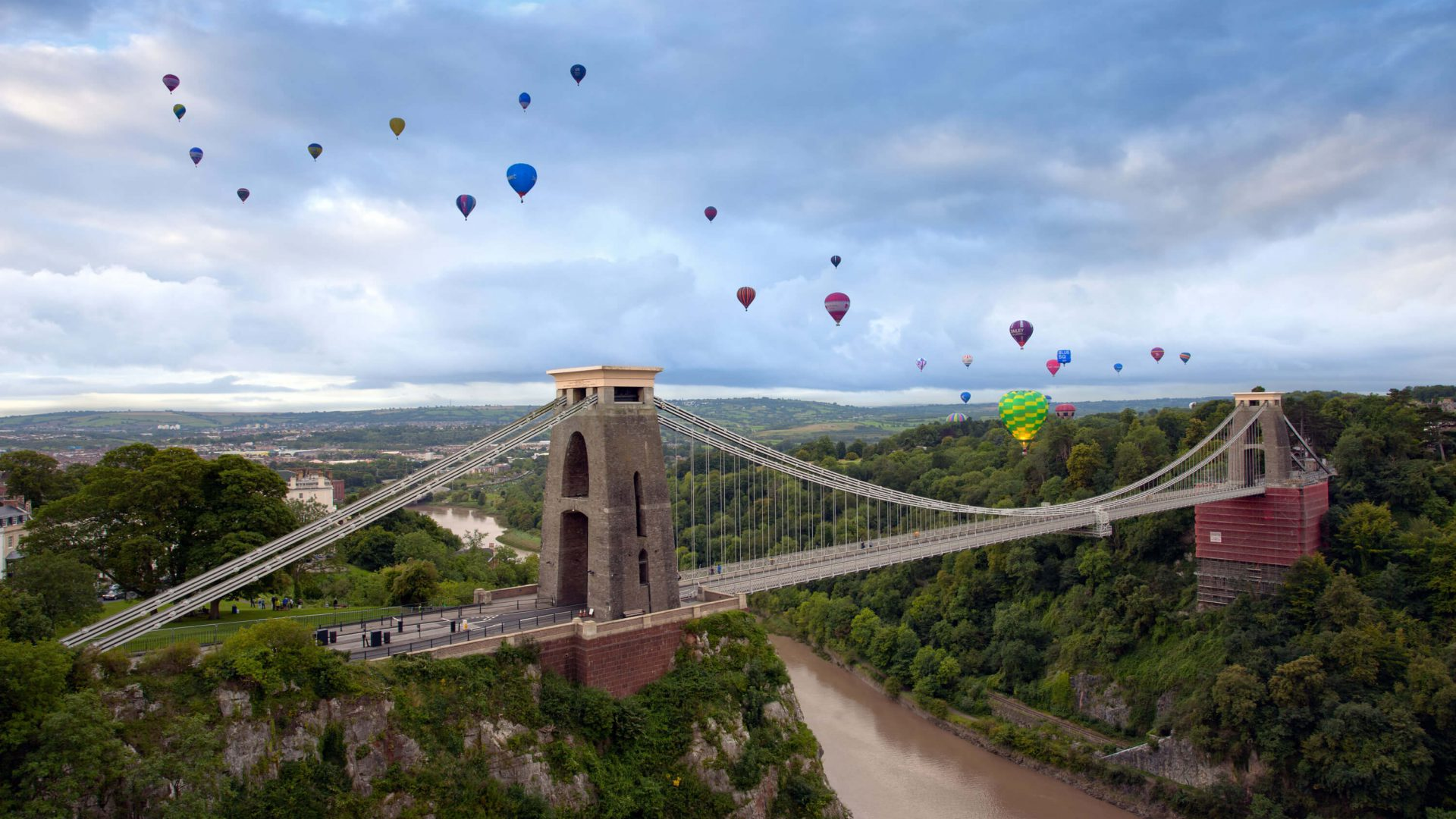 Bristol's Clifton Suspension Bridge is surrounded in the sky by colourful hot air-balloons