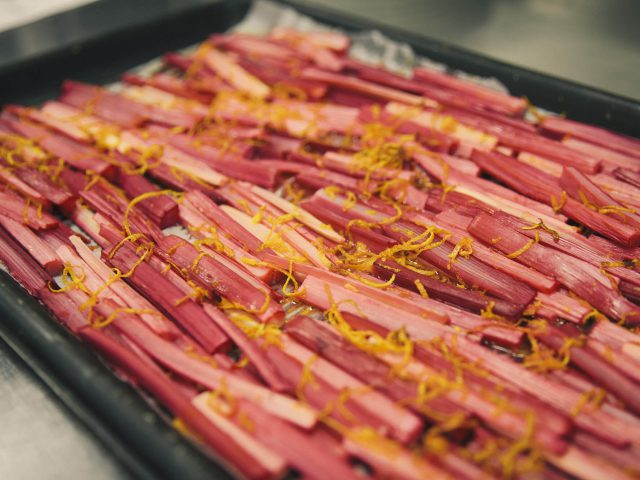 Rhubarb lines a baking tray for catering courses