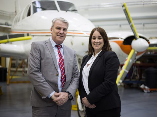 Richard Hyde, training leader, and Claire Thorogood, Director of Apprenticeships, at City of Bristol College standing infront of an airplane